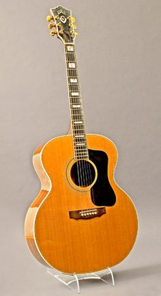 I have this guitar and it is my favorite.  A big sound and very percussive...