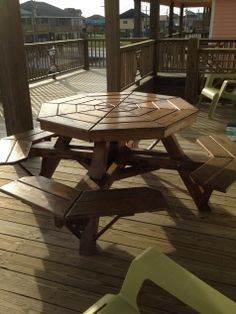 Barefoot Escape Crystal Beach vacation rental covered deck cedar picnic table.  For details go https://www.facebook.com/barefootescapebeachrental/
