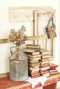 Cheap Rustic Decor: Rusted Cans, Jugs, Dried Flowers, Books, Remaindered Wood, Crates, Thrift Store Finds.