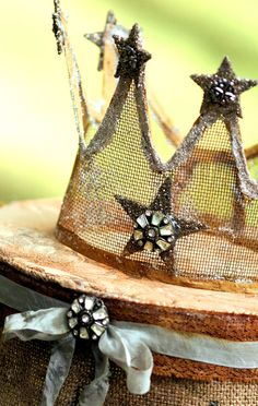 Jeweled crown from some old screen embellished with German glass glitter and faded ribbon. The crown is resting on a burlap pedestal with more faded ribbon and a vintage pin. Party Decoration, Girls Camp, Tiaras And Crowns, Lace Crowns, Crown Jewels, Party Hats, Party Favors, Altered Art, Just In Case