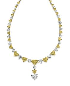 Cora Heart-Shaped Fancy Yellow Diamond Necklace set in 18K Yellow Gold and Platinum #GOWS #platinumlist #weddingstyle #graceormonde #luxuryweddings