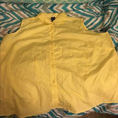 New 3X Button Down Yellow Tank Top New with tags.  Yellow basic button down tank top.  Size 3X.    Important:   I make sure all items are freshly laundered as applicable (shoes and tagged items, I don't remove the tags and wash).  However, not all my items come from pet/smoke free homes.  Low pricing reflective of this. Thank you for looking! Tops Button Down Shirts