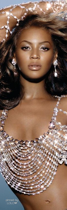 Beyonce has the right idea with this costume...why wear fabric when you can wear bling? <3