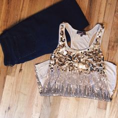 Almost Famous Sequin Tank Top✨ This sequined tank top is super comfy, with enough flair to dress up any casual summertime outfit. The size is large, but fits more like a medium. Almost Famous Tops Tank Tops