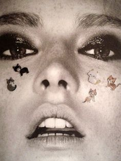 cat stickers on your face.