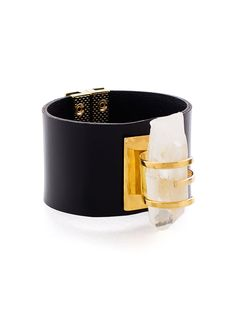 CRYSTAL ON LEATHER GOLD BRACELET $284.00 Natural, hexagonal rock crystal and a supple, high quality black leather strap make this cuff sleek and tough.Francesca Romana Diana was inspired by the Art Deco Movement of the 1920's when she created the Atlantis Collection. #‎Fashion‬ ‪#‎Design‬ ‪#‎Womens‬ ‪#‎Accessories‬ ‪#‎Bracelet‬