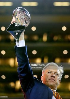 Denver Broncos general manager John Elway holds up the Vince Lombardi Trophy after defeating the Carolina Panthers during Super Bowl 50 at Levi's Stadium on February 7, 2016 in Santa Clara, California. The Broncos defeated the Panthers 24-10.