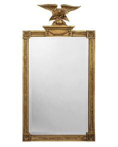 Wood and composition rectangular beveled pier mirror with eagle and additional applied decoration. Shown in standard antiqued gold metal leaf finish.