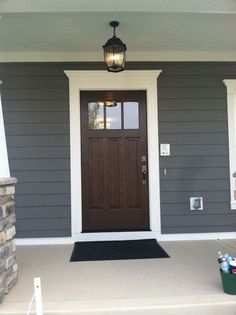 Front door with windows, blue color of house with white trim