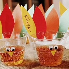 "Turkey Cups    Don't get trapped in a continuous ""Is that my drink?"" loop. Make sure all your guests can find their cups by gluing on a few colorful turkey feathers. Write each person's name on the feathers, and then add some googley eyes and a triangle beak to finish."