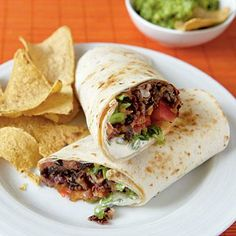Dave and I LOVED these!!!  Subbed Greek yogurt in place of sour cream. Chipotle Bean Burritos | CookingLight.com