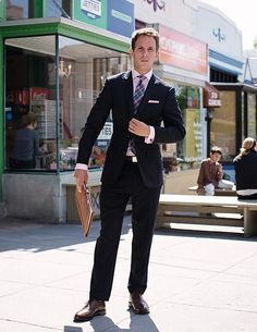 A suit is a safe choice...and always bring a padfolio or professional tablet!
