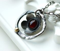 Organic flower pendant necklace with 14 carat gold, sterling silver and red garnet by Echoes of Norway, via Flickr