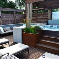 Roof deck with hot tub, bar area and seating area | Yelp