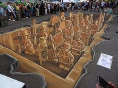 3D Lego Chalk Drawing. Created for the Sarasota Chalk Festival in Florida, this amazing mashup of Legos and Terracotta warriors was magnificent in every sense of the word. Notice that at certain angles, the piece looked completely distorted and almost completely unrecognizable.