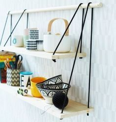 DIY Hanging Rope Shelf(via Flexible Ways To Decorate With Hanging Shelves)