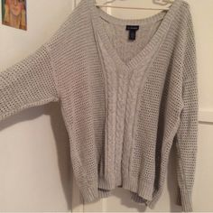 Silver sweater Plus size in good condition. So comfy and loose. Lane Bryant Sweaters V-Necks