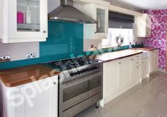 Ral 5018 - Turquoise Blue Splashback with up stands recently fitted in this beautiful shabby chic style kitchen. It is the perfect contrast to the bright pink and white - simply stunning! Fitted by Splashbacks NI