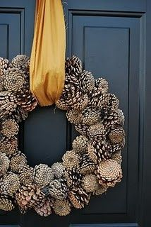 winter wreath...pretty pine cones with gold and blue contrast