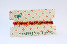 diy cardboard bracelet display @Angie Hutchison this is a cute idea