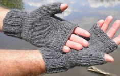 Mens fingerless gloves are hand knit in charcoal gray 85% merino wool and 15% mohair yarn. These gray mens fingerless gloves are knit with ribbing at the wrist and knuckles for a close, warm fit, and smooth stockinette stitch throughout the rest of the glove for a classic, tailored