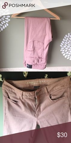 American Eagle jeggings In excellent condition!  Purchased to wear to work right after having my last baby. Worn only a few times and now they are too big. Beautiful dusty rose color. Looks great with s gray or olive colored top. American Eagle Outfitters Pants Skinny