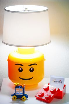 Fun bedside decor for an awesome LEGO bedroom. Fun bedside decor for an awesome LEGO bedroom. Lego Theme Bedroom, Lego Room Decor, Bedroom Themes, Boys Lego Bedroom, Bedroom Ideas, Lego Regal, Bedroom Lamps, Bedroom Decor, Bricolage
