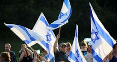 An estimated 2800 people attended a Solidarity Rally for Israel outside at the Mandel JCC's Safran Park Tuesday, July 22, 2014, in Beachwood. Hosted by the Jewish Federation of Cleveland, the Solidarity Rally for Israel was planned in response to the strong community desire to unite in support of Israel. The recent escalation of violence in Israel and a rise in anti-Semitism worldwide has many community members calling out for peace and tolerance. (Joshua Gunter/ The Plain Dealer)