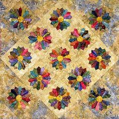 Edyta Sitar shows us a contemporary Dresden Plate quilt, using rich, deep batik colors.