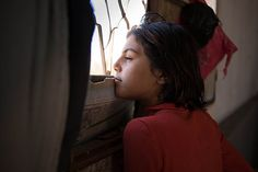 """28 August 2013 - One million child refugees have now fled the escalating war in Syria. Fatima, 10, and her parents escaped Syria's conflict-affected Baba Amr district of Homs and now live in an enclosed room atop a roof in Mafraq, Jordan. """"We don't have water. I get it from the neighbours,"""" she said. Sometimes her family is also without food. """"I miss Syria. I was very happy...My school was very beautiful."""" Fatima dreams of one day becoming a doctor. ©UNICEF/Lucy Lyon"""