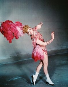 Sonja Henie, figure skating champion and movie star, in pink.