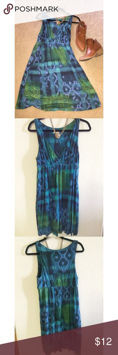 Cool print empire waist dress Pretty blue green pattern would look great with strappy sandals or summer wedges. Cross v-neck is flattering. 100% stretchy rayon with extra lining. Dress sits 24 1/2 inches long at waist. Matty M Dresses