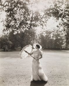 Queen Elizabeth,later the Queen Mother, 1939, very elegant, very glamorous,  very chic in a dress designed by Sir Norman Hartnell and photographed by Sir Cecil Beaton in the gardens of Buckingham Palace.