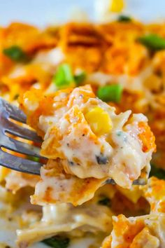 Doritos Casserole with Chicken is an easy weeknight dinner recipe using rotisserie chicken. This creamy chicken casserole is loaded with cream cheese, corn, shredded cheddar and topped with crumbled Doritos.