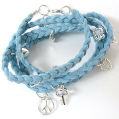 """Light Blue Faux Suede Silver Tone Charm Wrist Wrap Bracelet or Necklace Heirloom Finds. $8.99. Features 11 Fun Charms. Trendy Wrist Wrap Charm Bracelet. Arrives in Gift Box - Perfect for Gift Giving or Treat Yourself. Wear as a Bracelet or Necklace. Measures 27""""long with a 3"""" Extender. Save 31% Off!"""