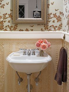 """Honeybee"" wallpaper by J.R. Burrows & Company and a Lincrusta wainscot make this a guest-ready powder room."