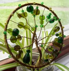 Tree of Life. Metal hoop from craft store. Spool of copper colored wire from Jewelry department at craft store. Various beads in various colors. Needle nose pliers and an imagination. Have fun