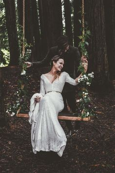 outdoor boho swing of a simple wooden piece, rope and some greenery