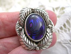 Beautiful vintage c1970s Native American sterling silver ring in a womans size 6. A gorgeous bezel set Paua shell in rich, deep blues and