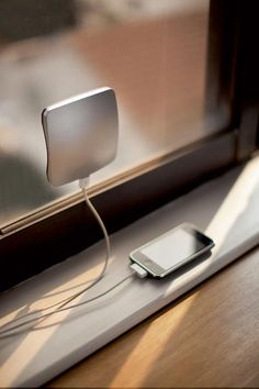 Solar Window Charger – sun energy charger for window mounting. XD Design solar window charger, with big USB and small USB output, is easily attachable to your window. Solar Phone Chargers, Solar Charger, Portable Charger, Solar Battery, Solar Lights, Wind Charger, Indoor Lights, Gadgets And Gizmos, Tech Gadgets