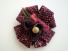 Nesting Rosette - Pink Tweed (1) Pink and black tweed rosette with silk, feather and wooden bead embellishment  Nesting Rosette - Pink Tw...