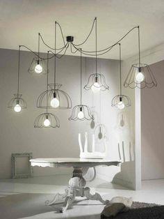 Minimalistic Chandelier with Multiple Lampshades Outlines via Côté Maison