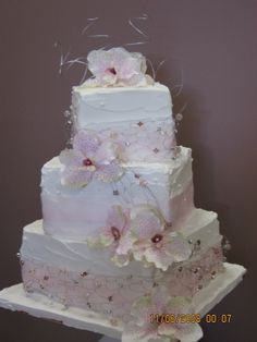 Square Oriental Orchid Wedding Cake - I love this cake. So elegant. I used a homemade spreadable royal icing to cover cake and used a lovely beaded wire to decorate with and the Soft pink Oriental Orchids.