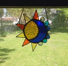 Stained glass sun and moon