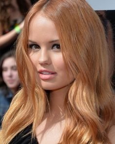 Whether you believe it or not, strawberry blonde hair is a trendy and very popular hair color solution. This color is a brilliant warm reddish blonde hue