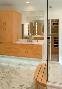 Calacatta marble floor and countertops, floating marble cabinets