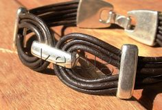 unisex men women multi strap brown leather bracelet with silver spacers beads.