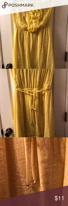 Cute yellow dress Fun yellow sleeveless mini dress. Size Medium. Only worn a couple of times. Comfy and flattering. Sheer top layer over solid bottom layer, so can be worn without a slip. Great condition. Only minor defect is that one of the silver rings on the end of the tie is missing (see picture) but it does not affect wearing the dress and the other one could easily be removed to match. No rips/holes/stains. Speechless Dresses Strapless
