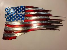 Tattered American Flag Metal Art Beautiful Tattered Metal American Flag This flag is made from high quality 16 Gauge Each piece is painted the red, white and blue then clear coated for a long lasting, clear finish. The flags measure 23 inc Rustic Wooden American Flag, Metal American Flag, American Flag Painting, American Flag Pallet, American Flag Wall Art, Metal Flag, Metal Art, American Flag Tattoos, Pop Art