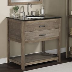 Rustic yet refined, this bathroom vanity will enhance the decor of your bathroom. The Elements bathroom vanity features sturdy solid wood legs and frame with a weathered brown/grey finish, and a solid black granite top.